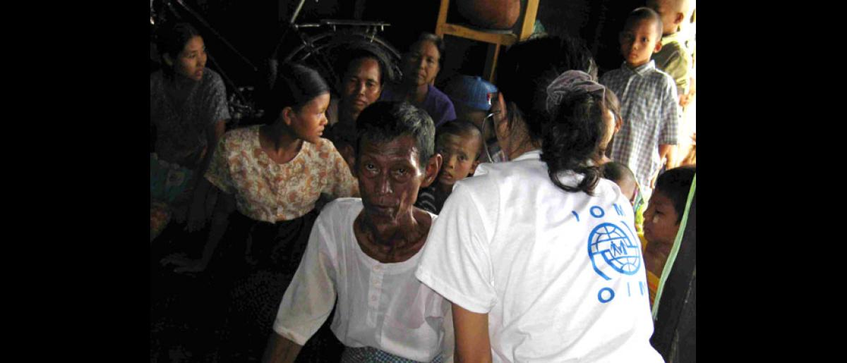LISTENING INTENTLY. An IOM doctor listens to the heart and breathing of a patient with a respiratory problem. Most of the cyclone survivors were found to suffer medical conditions related to unclean water and food, lack of proper shelter and clothing, and a lack of proper sanitation. © IOM 2008 - MMM00052