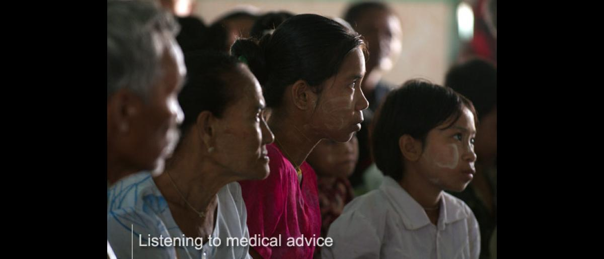 Villagers listen to a community health education and promotion session conducted by an IOM outreach team in Kyaung Su village monastery in November 2008. © IOM/Piers Benatar 2008 - MMM0371
