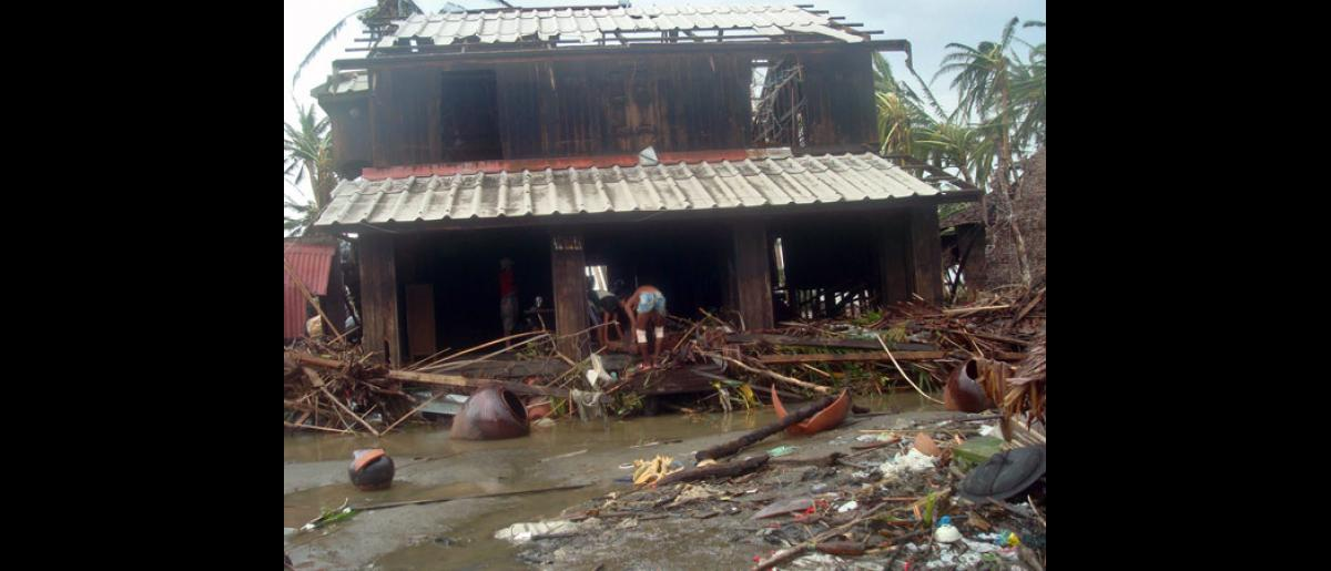 Even relatively sturdy structures such as this house have been severly affected. Additional heavy damaged was caused by a tidal wave that travelled up the river and killed many people. © International Federation of Red Cross and Red Crescent Societies