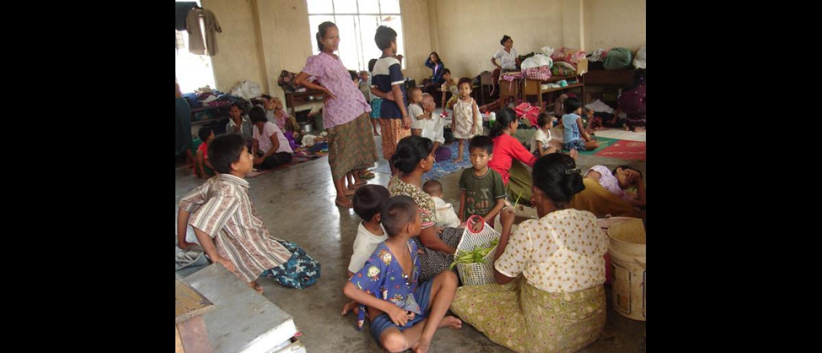 A pregnant woman and children are among those who are more vulnerable at this packed temporary shelter in Yangon. Myanmar Red Cross is supporting as best they can thousands of people in such conditions. © International Federation of Red Cross and Red Crescent Societies