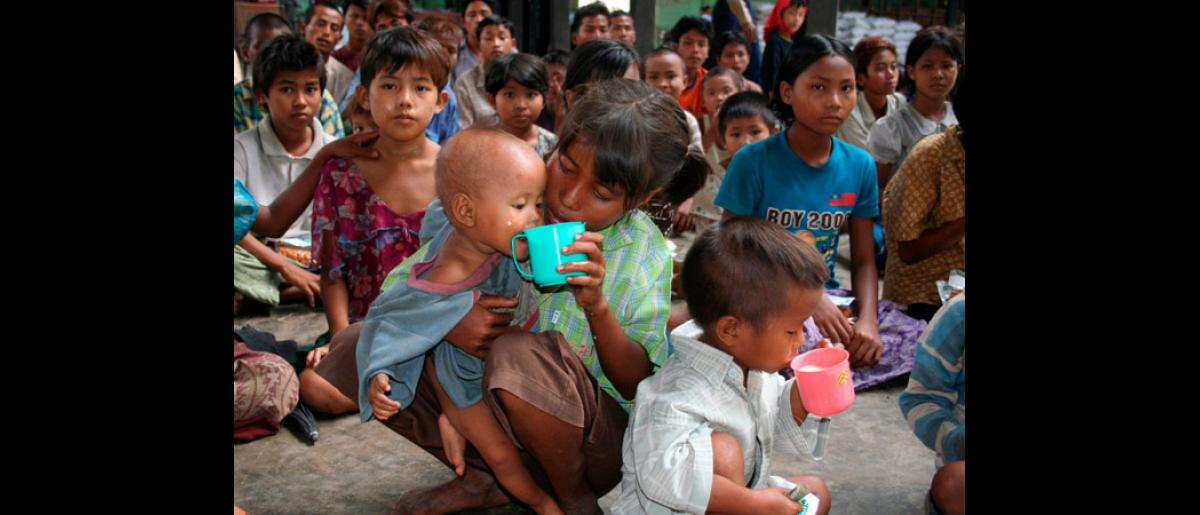 Children drinking powdered milk donated locally to Myanmar Red Cross in Myanmar cyclone hit areas. More than a week after cyclone Nargis struck, hundreds of thousands are still without access to food, water and medicine, threatening a health catastrophe that could increase the death toll 15-fold, aid agencies have warned. © EPA/International Federation of Red Cross and Red Crescent Societies
