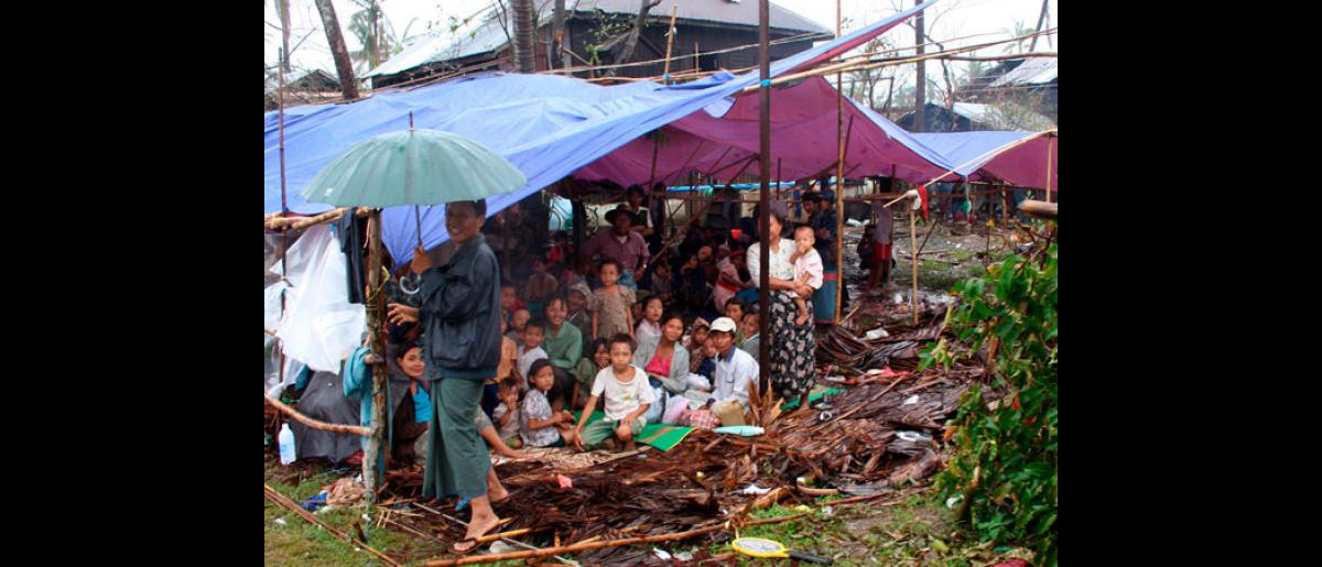 Cyclone victims taking shelter from the rain in Myanmar cyclone hit areas. International aid workers have expressed fears that warned torrential rains will add to the misery of up to 2 million people left in need of food, water, shelter and medicines in Myanmar after Cyclone Nargis, which smashed into the country's central coastal region May 2-3. © EPA/International Federation of Red Cross and Red Crescent Societies