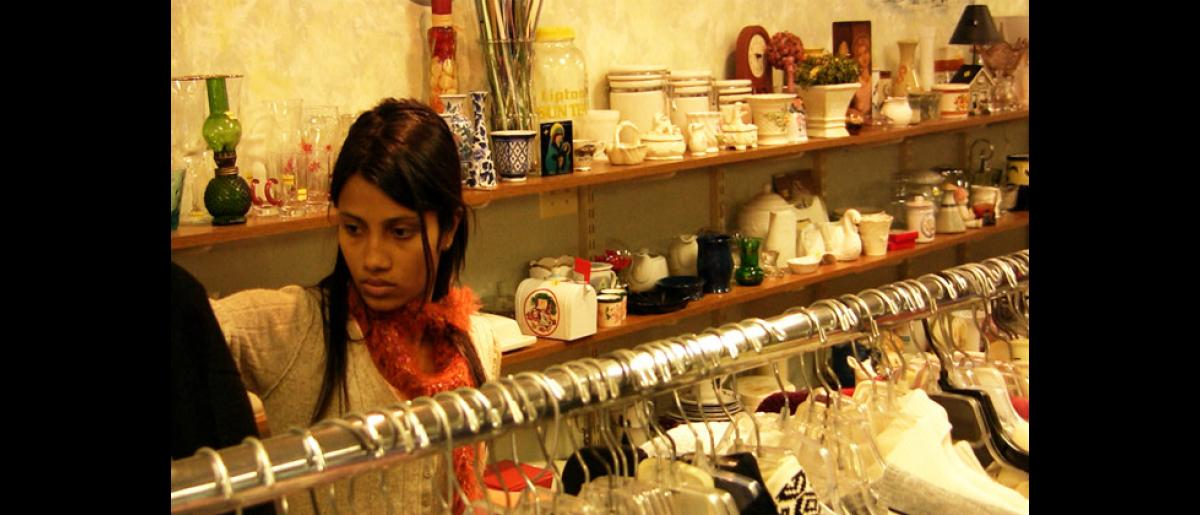 A resettled Bhutanese does some thrift shopping in Manchester, New Hampshire. © Doria Bramante 2008 - MUS0076