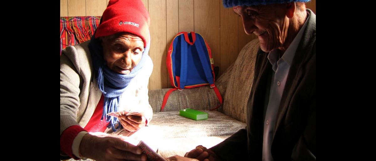 Bhutanese elders play cards in Manchester, New Hampshire. © Doria Bramante 2008 - MUS0069