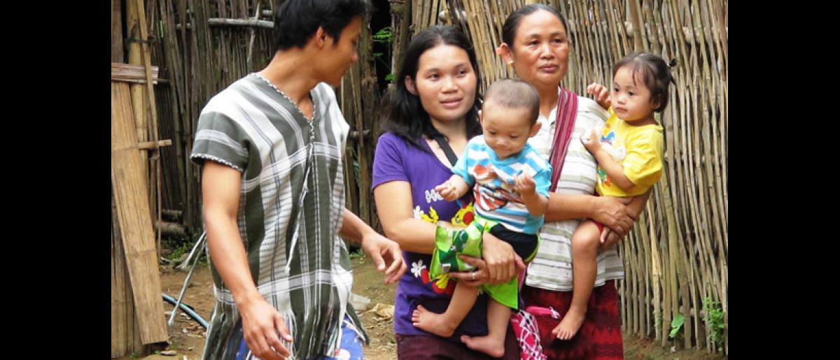 Ma Lay Lay (24), her children Labur Paw (3) and Ywar Mar Ser (11 months), her husband Christopher (26) and her mother just before their departure from Mae La camp in Northern Thailand. © IOM 2012