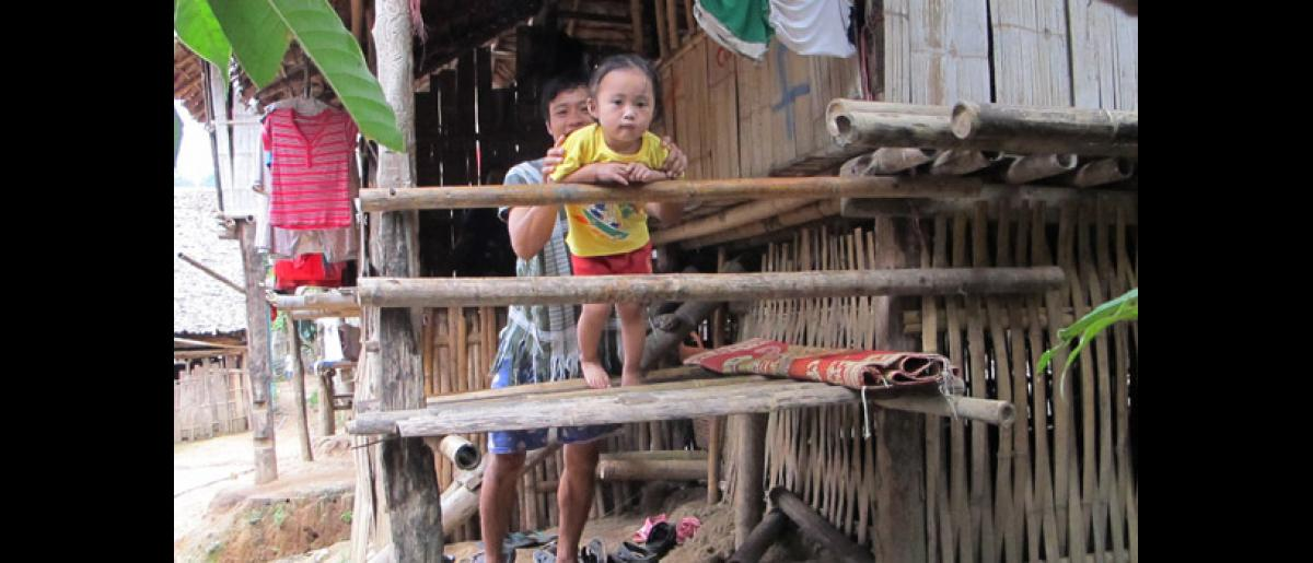 Labur Paw (3) and her father Christopher (26) at their home in Mae La refugee camp on the Thailand-Myanmar border. Labur Paw's mother Ma Lay Lay is the 100,000th refugee assisted to resettle by IOM Thailand in recent times. © IOM 2012