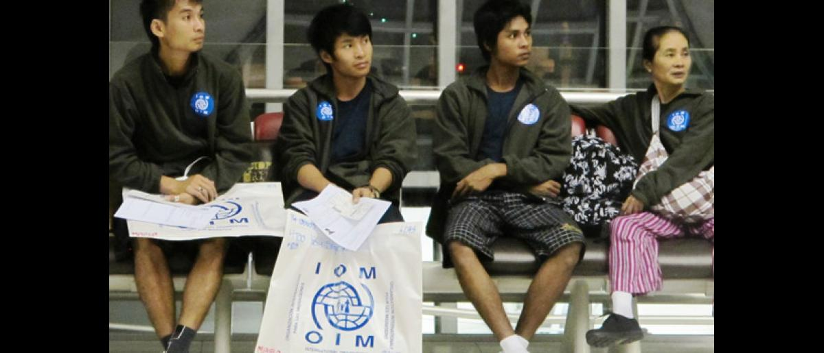 Myanmar refugees from Mae La camp, northern Thailand, at Bangkok International Airport prior to their early morning flight to the USA. © IOM 2012