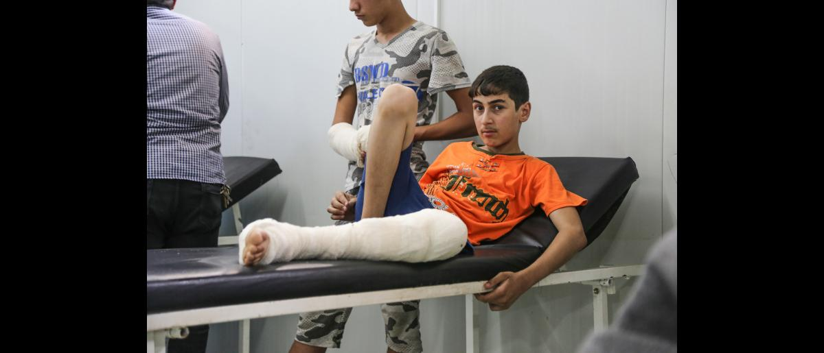 An injured Iraqi child at Hammam Al-Alil field hospital, south west of Mosul.