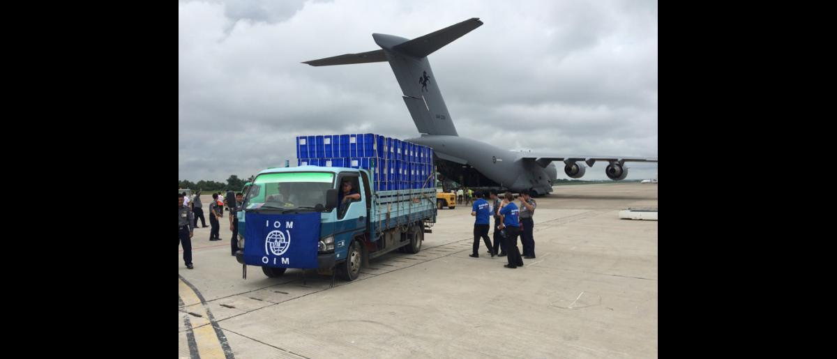 IOM staff receiving 500 family kits donated by the Australian Department of Foreign Affairs and Trade at Yangon International Airport (10 Aug). © IOM 2015
