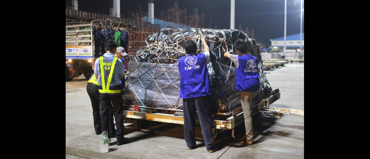 IOM Myanmar staff unloading shelter kits at Yangon International Airport (26 Aug). © IOM 2015