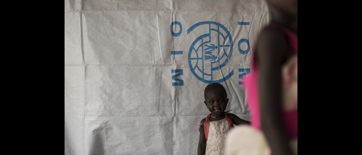 A child waits inside the IOM health facility. © IOM/Jacob Zocherman 2015