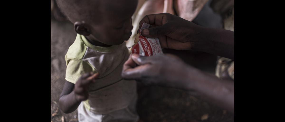 IOM provides supplementary feeding to a malnourished child. Food security experts project that vulnerable populations in Ayod County will face Emergency - level 4 on a 5-stage scale - level food insecurity during the May-to-July 2015 lean season. © IOM/Jacob Zocherman 2015
