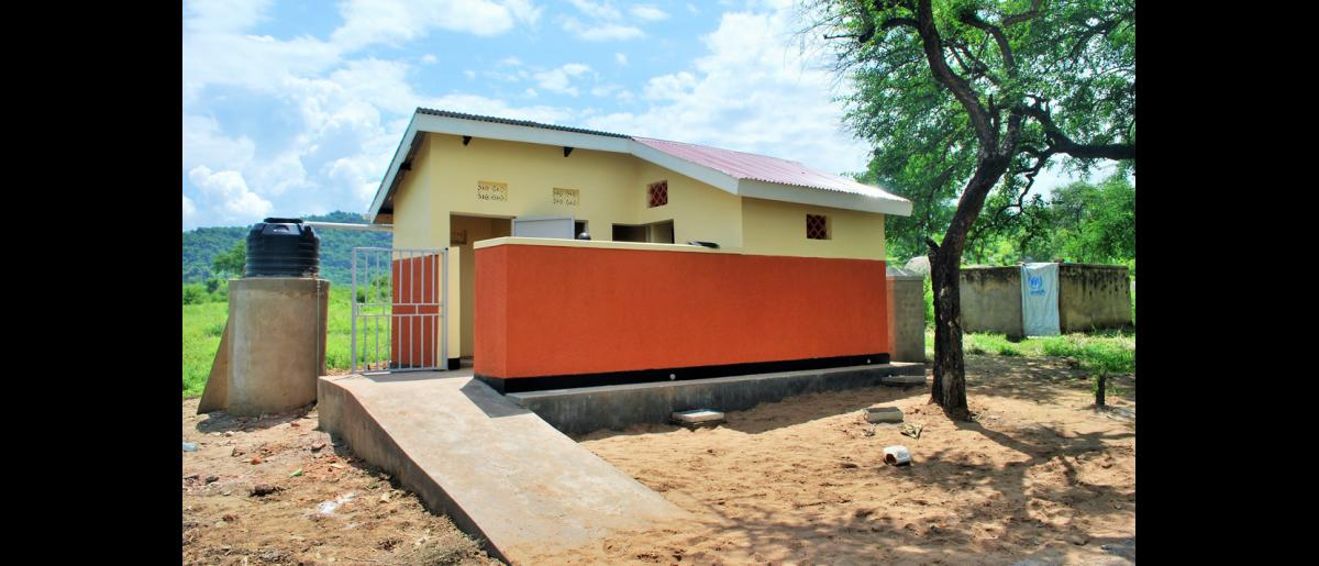 A five stance latrine for boys and male teachers at Palorinya secondary school. These facilities have handwashing facilities, and can be easily accessed by People with Disabilities. © Abubaker Mayemba / IOM 2018