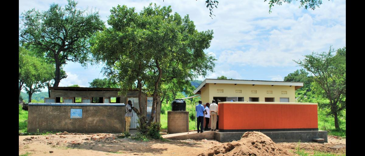 A five stance latrine constructed at Palorinya Secondary School. On the left is the older pit latrine which was previously shared by male and female students, and teachers. © Abubaker Mayemba / IOM 2018