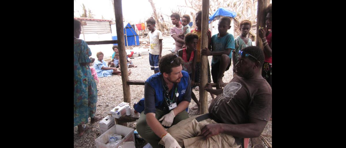 26 March 2015, Mataso island, Vanuatu: IOM's Emergency Health Team Leader Patrick Duigan dressed wounds, provided primary health care, and vaccinated children against measles. © IOM/Maria Moita 2015