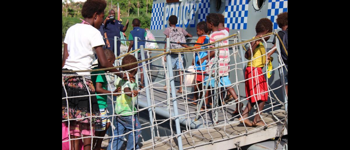 13 May 2015, Mataso island, Vanuatu: Passengers embark for the return journey. A Solomon Islands patrol boat and a Vanuatu police boat facilitated the evacuation and return. © UNDP/Francisco Santos-Jara del Padron 2015