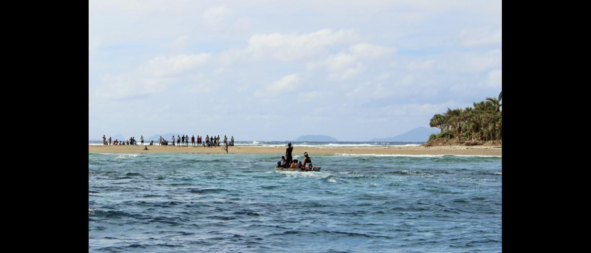 13 May 2015, Mataso island, Vanuatu: The community waits expectantly on the beach for family members to return. © UNDP/Francisco Santos-Jara del Padron 2015