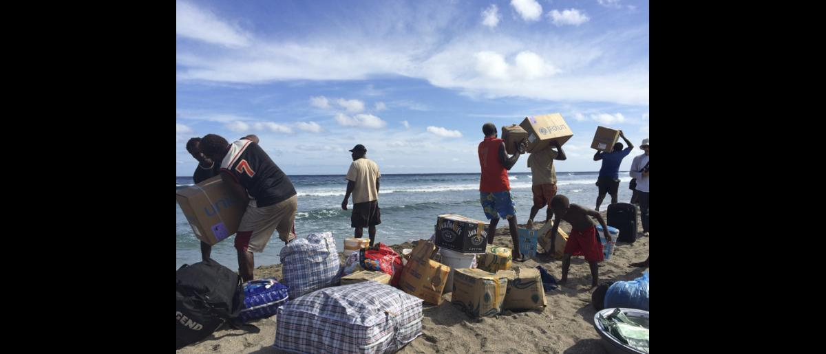 13 May 2015, Mataso island, Vanuatu: Items to support community recovery, including fishing materials, mosquito nets, tool kits, seeds and education materials, line the beach. © OCHA/Yaëlle Link 2015